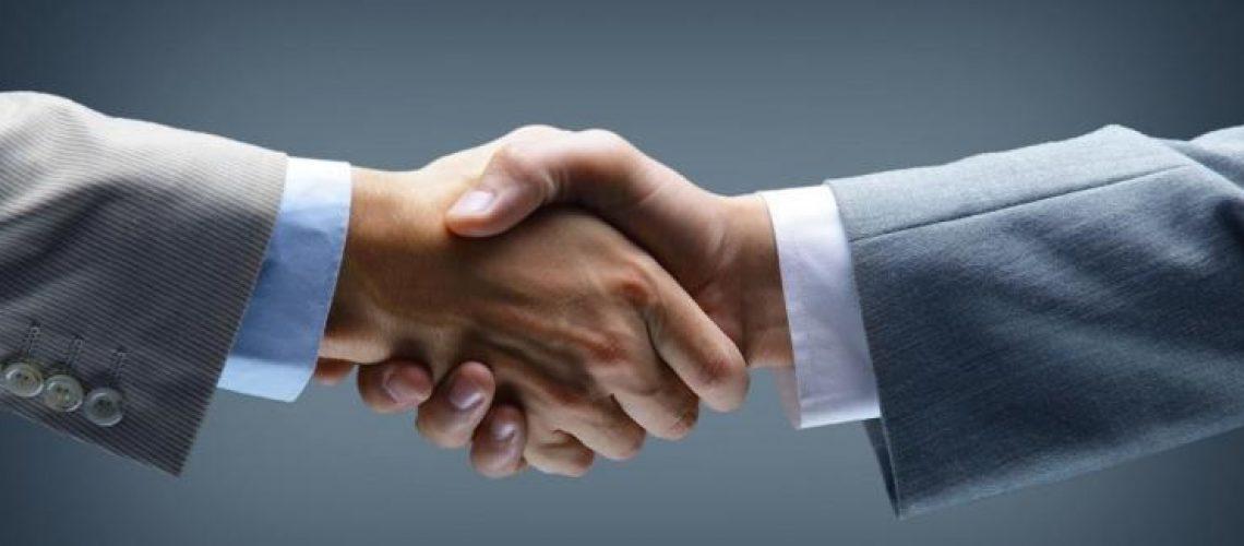 handshake_-_hand_holding_on_black_background